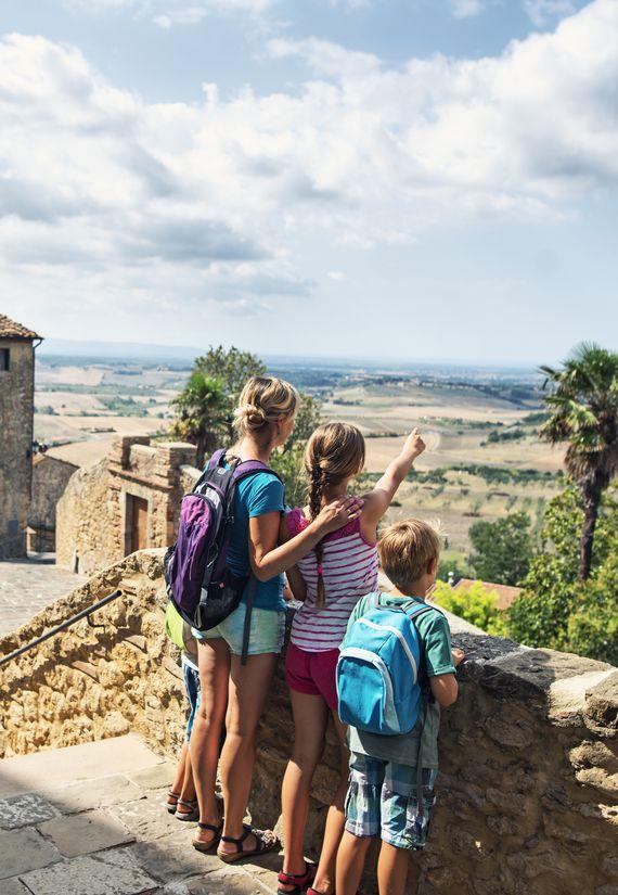 Family Enjoying View In Little Italian Town
