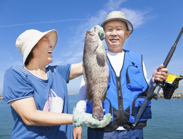Asian Couple Beach Fishing